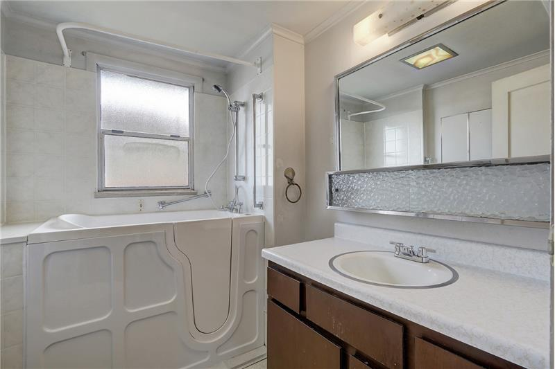 Bathroom with easy access jetted tub.