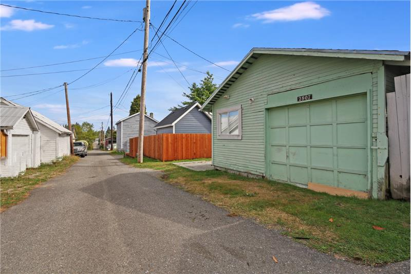And from the east, another shot of the detached garage and alley.