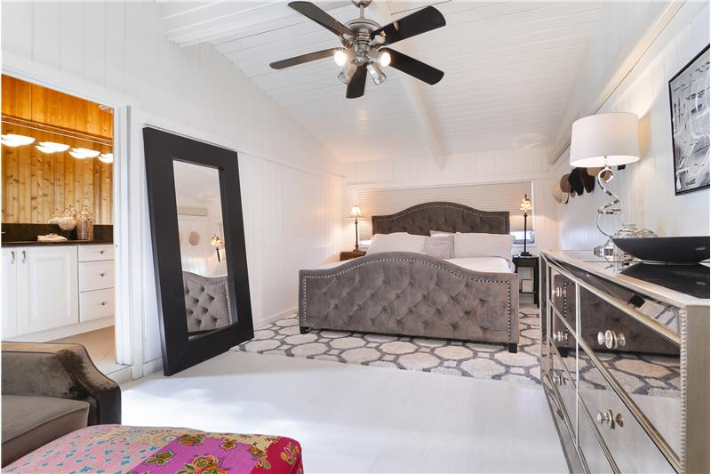 3rd Bedroom can double as another Master suite. Beautiful high beam wood ceilings with detail and design throughout.