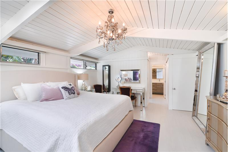 Gorgeous Master bedroom has a Skylight & windows w/blackout shades plus a walk-in closet and such amazing architecture.