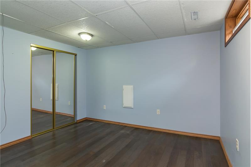 One of the basement bedrooms