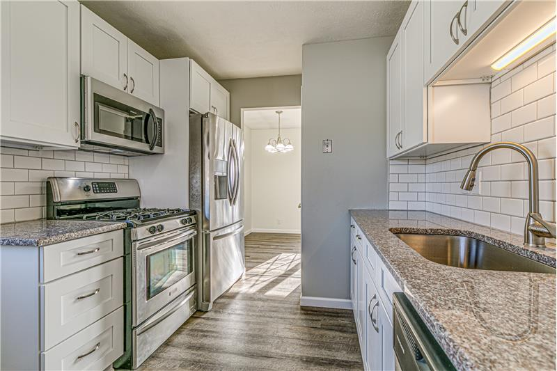 Renovated kitchen - granite countertops and so much more!