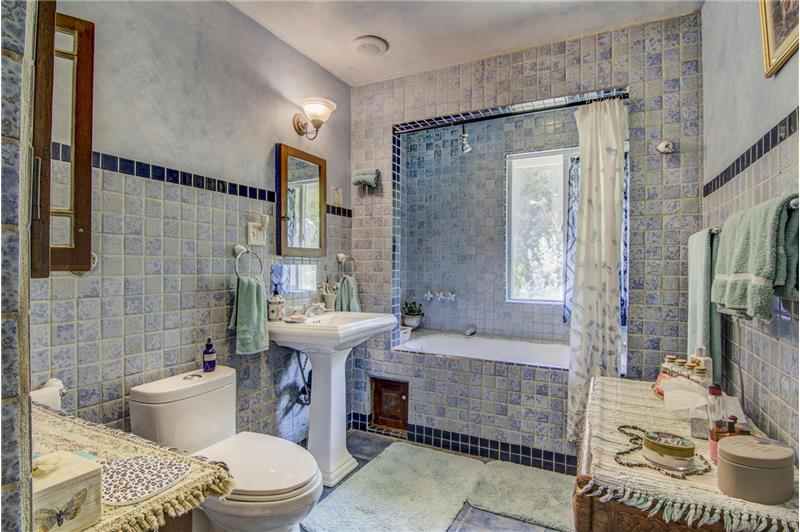 Large soaking tub with overhead shower