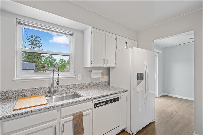 New slab granite countertops in kitchen