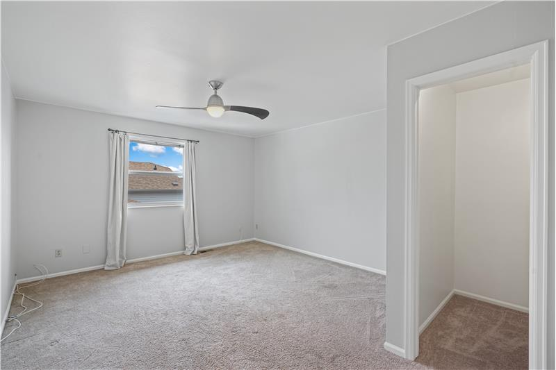 Master bedroom has walk-in closet and ceiling fan