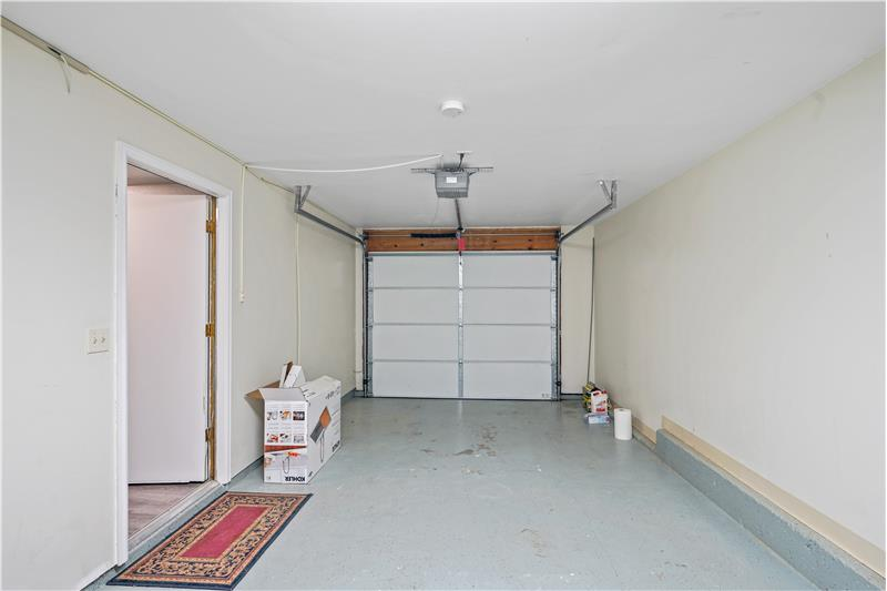 Garage is insulated and finished with epoxy floor; view is from door to the addition