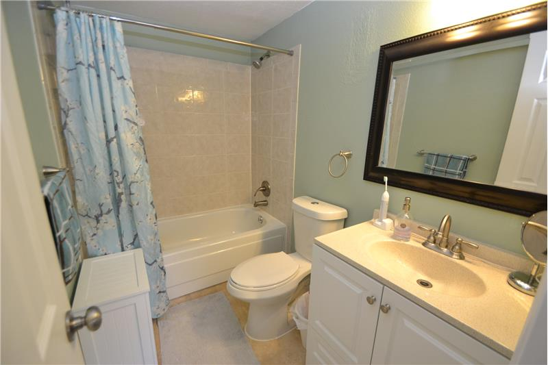 Master bathroom includes tub/shower and dual-flush toilet, updated vanity