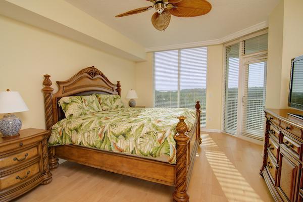 Master bedroom opens to balcony w bay views