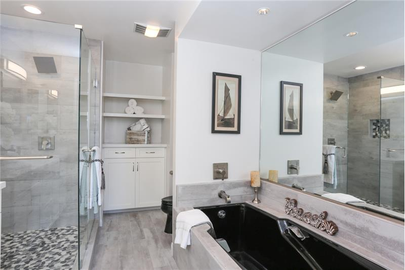 Remodeled Master Bathroom with deep tub & glass shower.