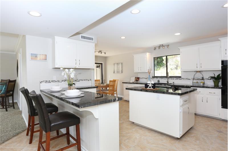 Beautiful new granite countertops & new appliances.