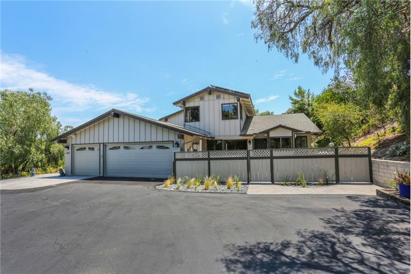 Oversize 3 car garage with refrigerated wine cellar. RV parking or room for up to 7 cars in the parking area.
