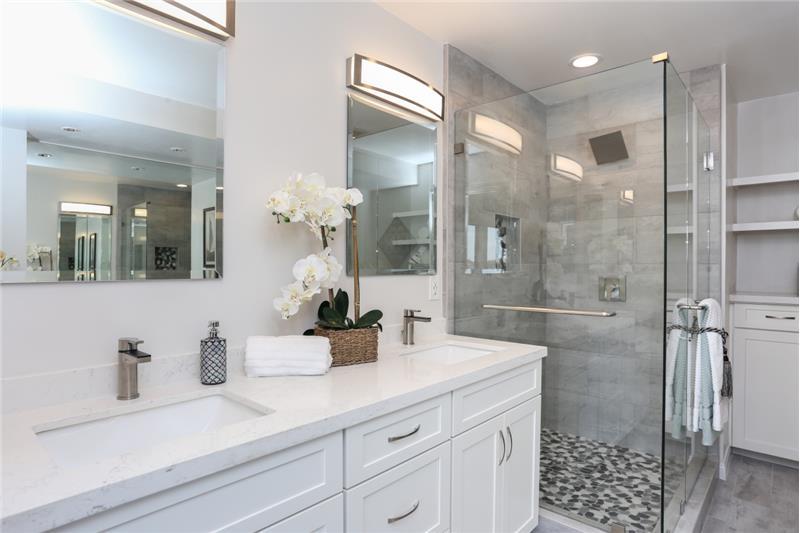 New shower, cabinets & quartz countertop.