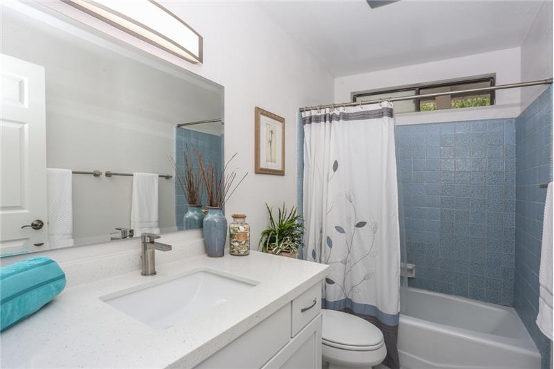 Updated upstairs bathroom with new vanity & quartz countertop.