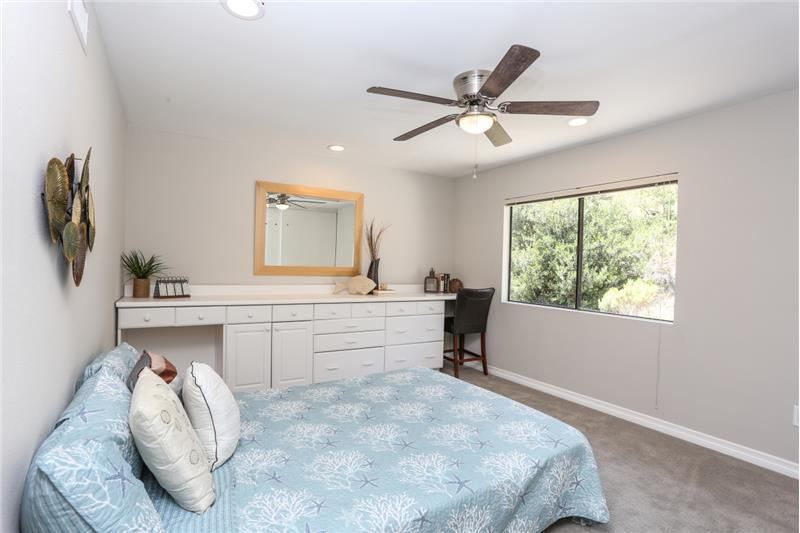 Large upstairs bedroom with extra cabinets.