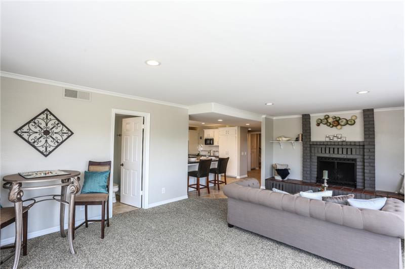 Large Familyroom with fireplace and view.