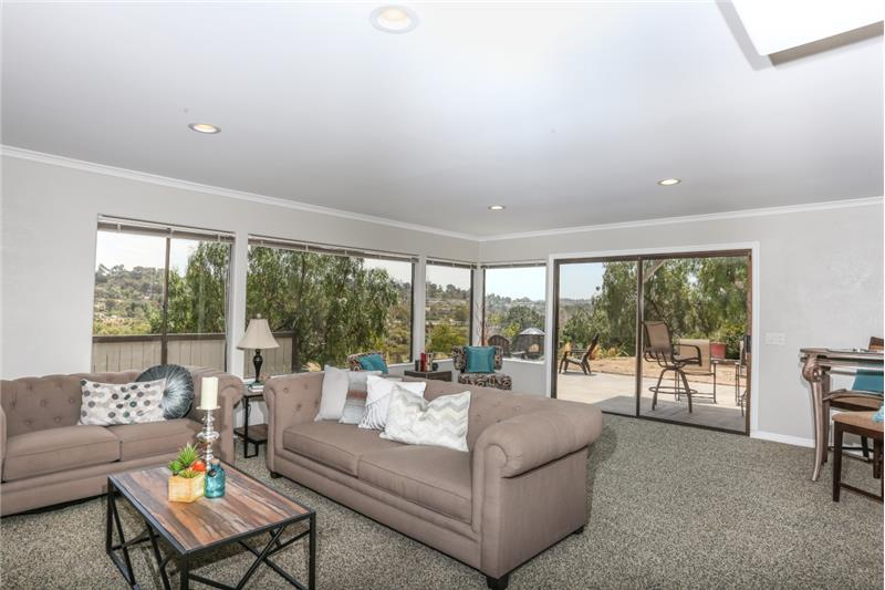 Large Familyroom with fireplace and great view.