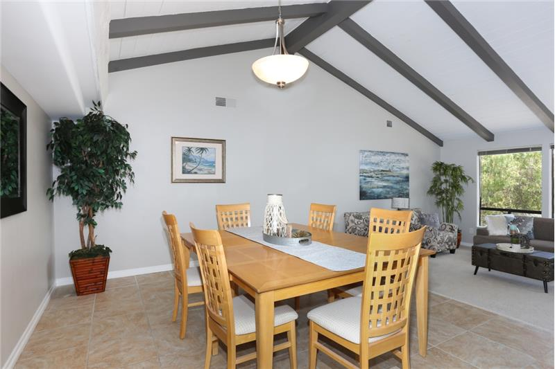 Large dining room with vaulted ceilings and a view.