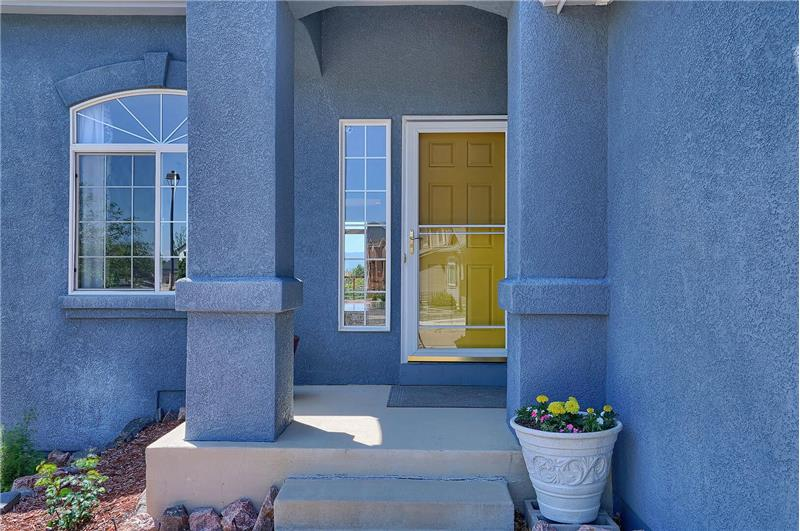Covered front porch with storm door entry