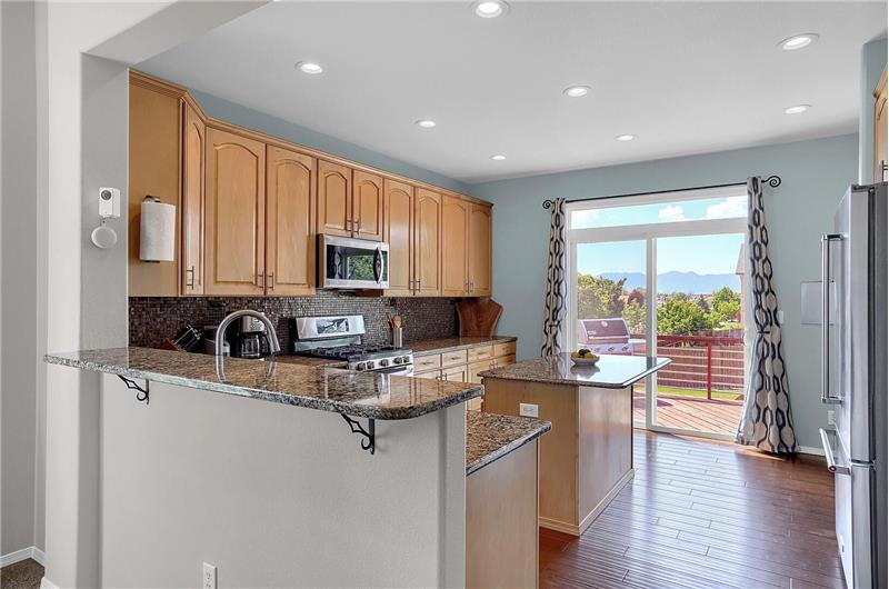 Island Kitchen with slider to the backyard deck