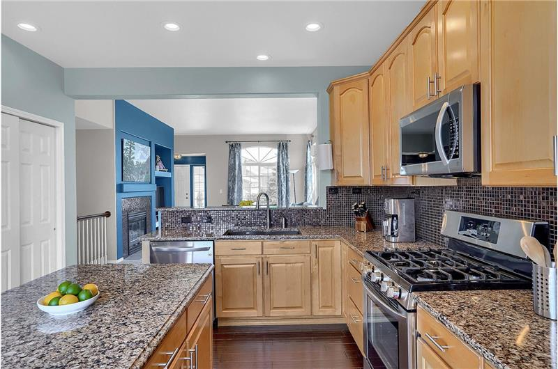 Stainless steel appliances include a dishwasher, gas range oven, built-in microwave oven, and French door refrigerator