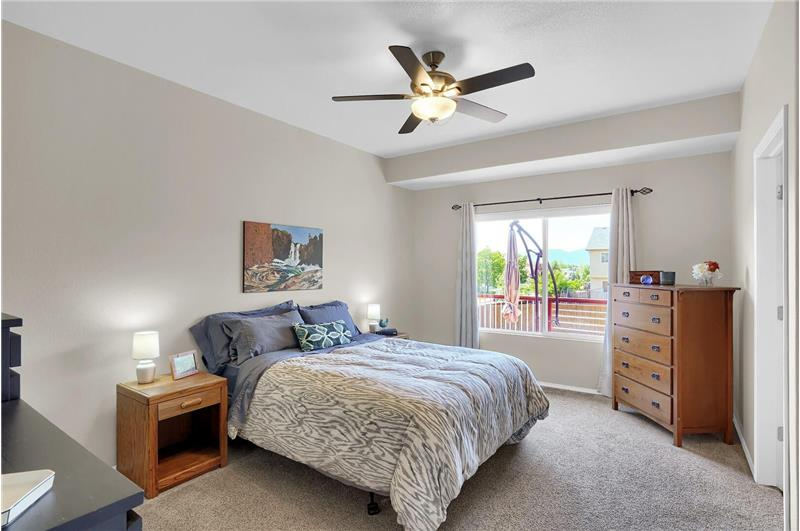 Well-appointed main level Master Bedroom features cellular blinds, a walk-in closet, and an adjoining Master Bathroom