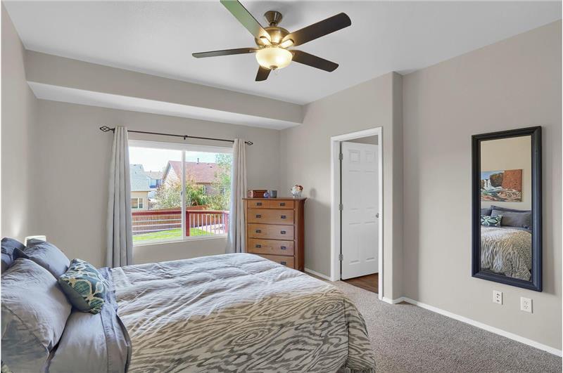 Main level Master Bedroom has views into the backyard