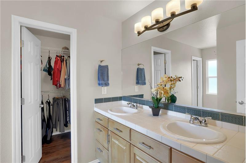 The Master Bathroom offers a luxury vinyl plank floor, dual sink vanities, and a walk-in closet