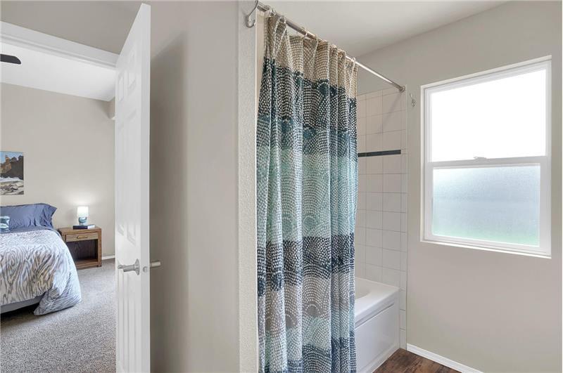 The Master Bathroom also hosts a tiled tub/shower