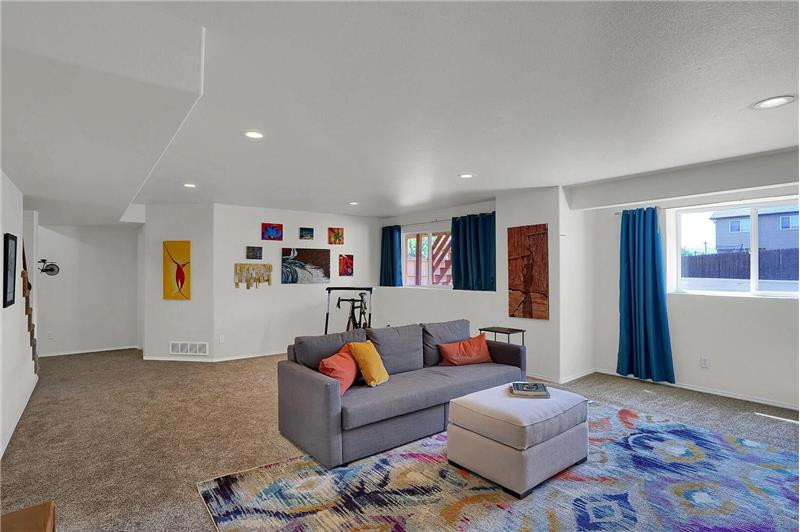 Basement Family Room with large windows that bring in lots of natural sunlight