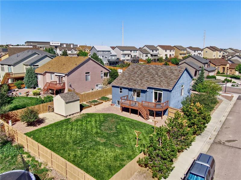 Aerial view of lot with mature trees for curb appeal and privacy