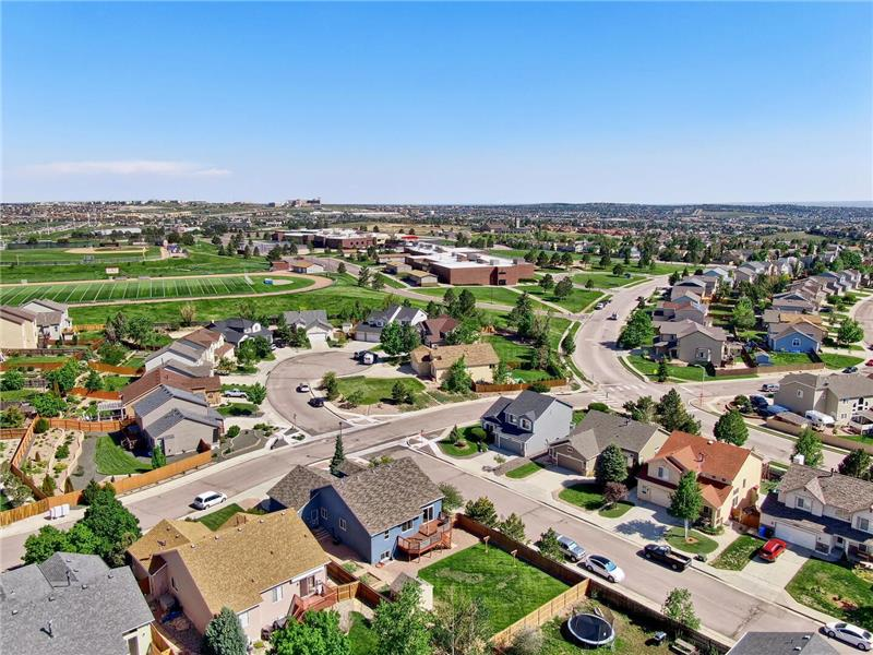 Aerial view of lot and neighborhood