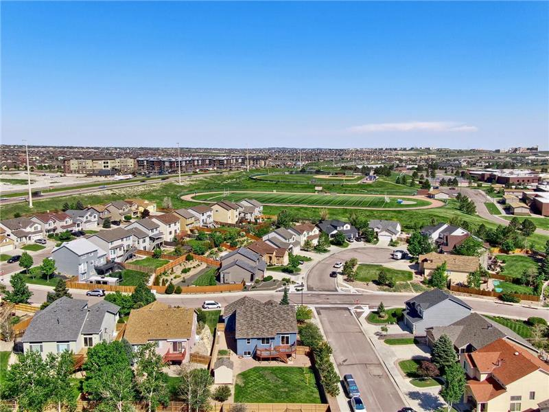 Aerial view of the back of the home and neighborhood
