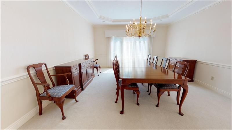 Easily accommodate 10-12 guests in this lovely formal dining room!