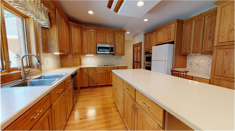Wonderful kitchen with center island, hardwood floors, double ovens, and all appliances included!