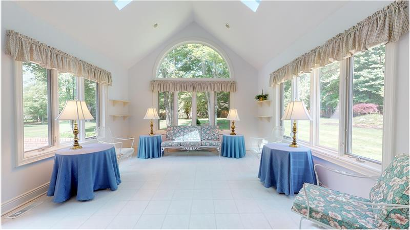 Relax or entertain in this natural light filled 4 season sun room! Ceramic tiled floor and access to the patio!