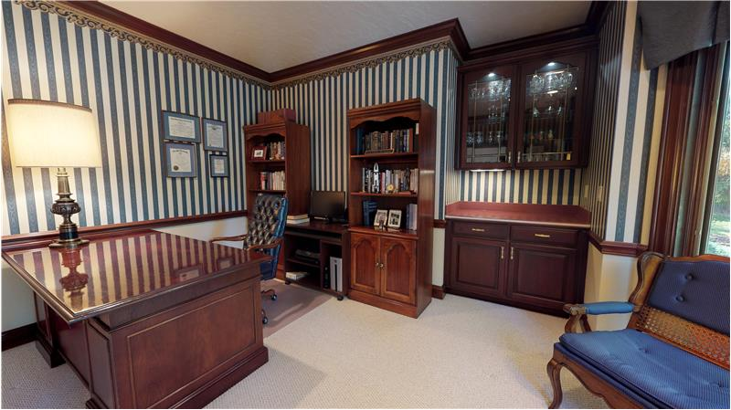 Handsome library with beautiful built ins.
