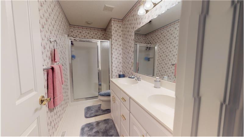Full bath adjacent to bedroom number 2 with ceramic tiled floor!