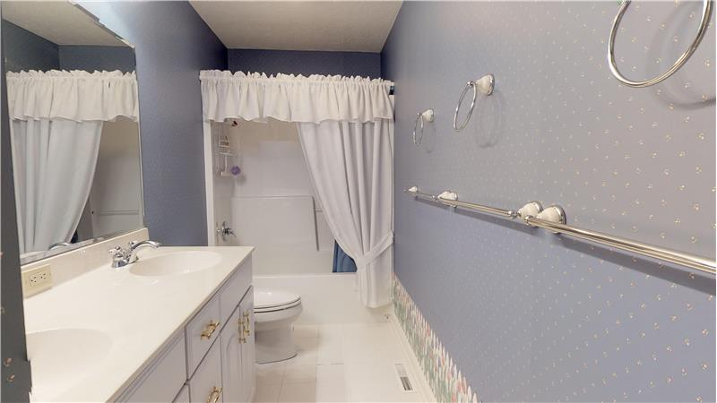 Second full bath with ceramic tiled floor on the second floor adjacent to bedrooms 3 and 4.