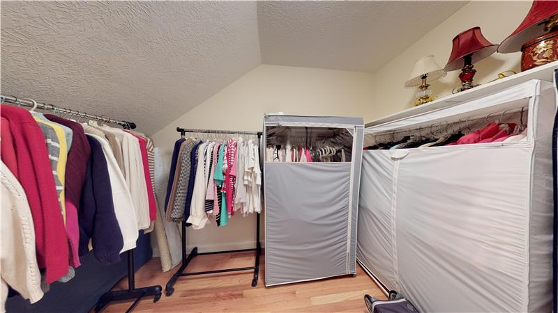 This is a huge closet with hardwood floors on the second floor!
