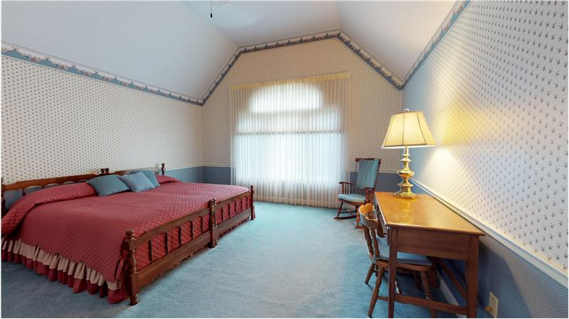 Bedroom 4 on the second floor withe vaulted ceiling and large walk in closet!
