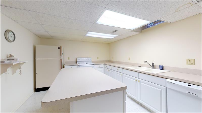 Second kitchen in the basement makes that extra food preparation so much easier!