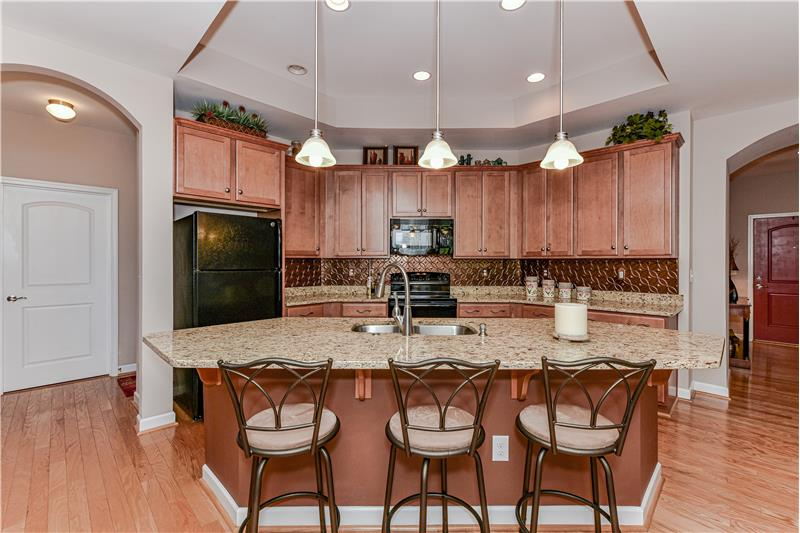 A cook's and entertainer's dream... lots of counter and cabinet space, large island with seating.