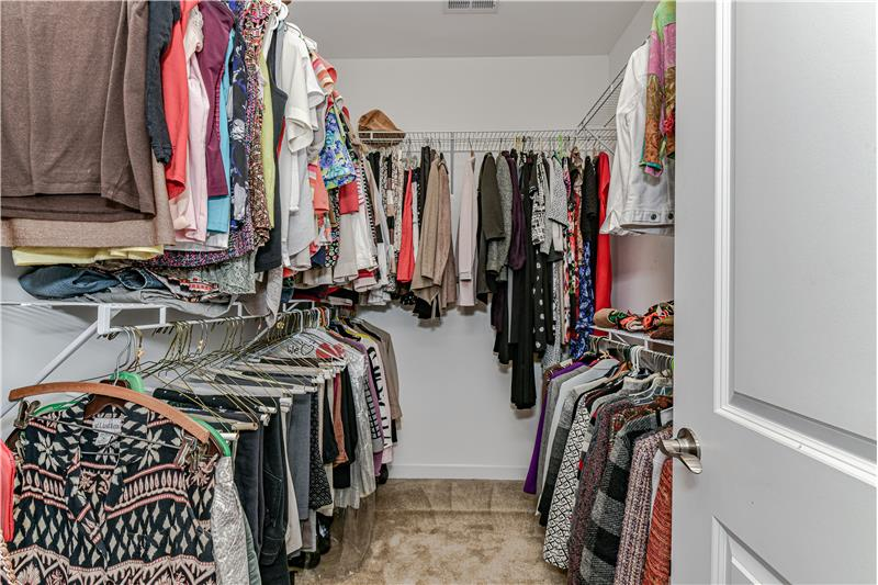 Good-sized, walk-in master closet.