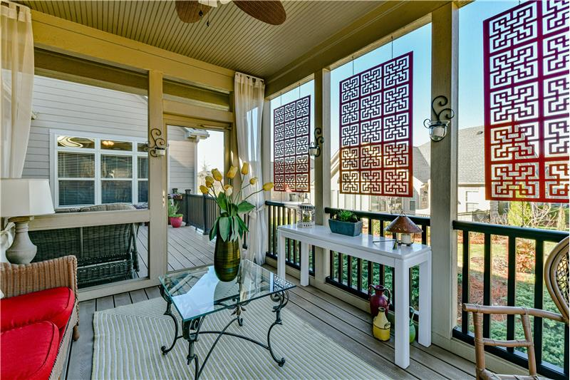 Custom built screened porch is perfect for relaxing on a hot day.