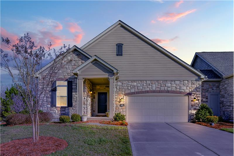 Welcome home to 5218  Polo Gate Boulevard, located in Polo Club at Mountain Island Lake, a 55+ Active Adult Commu