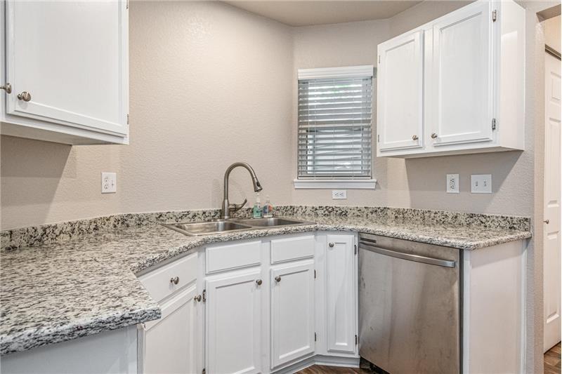 Kitchen has slab granite countertops