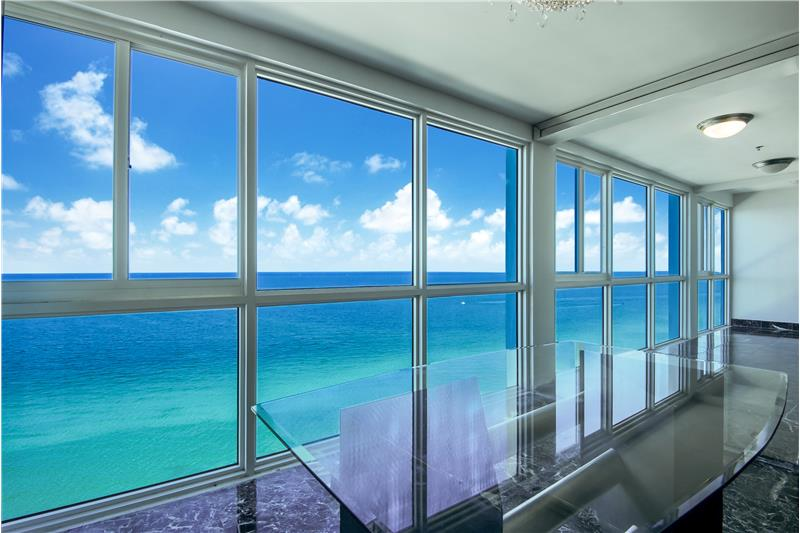 Balcony enclosed with impact glass and amazing ocean views.