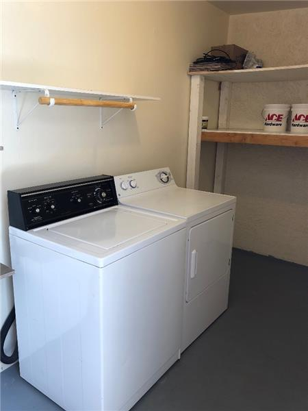 Large storage room with washer/dryer included