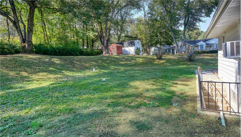 Plenty of room to play, relax, or garden on this half acre lot.