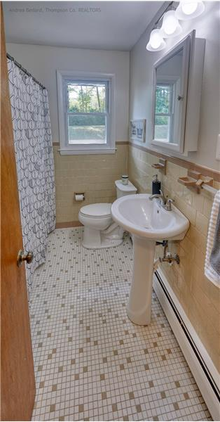 Original charm with modern upgrades. There's a large linen closet behind that door!